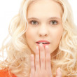 Teenage girl with palms over mouth — Stock Photo #7253259