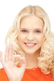Lovely teenage girl showing ok sign — Stock Photo
