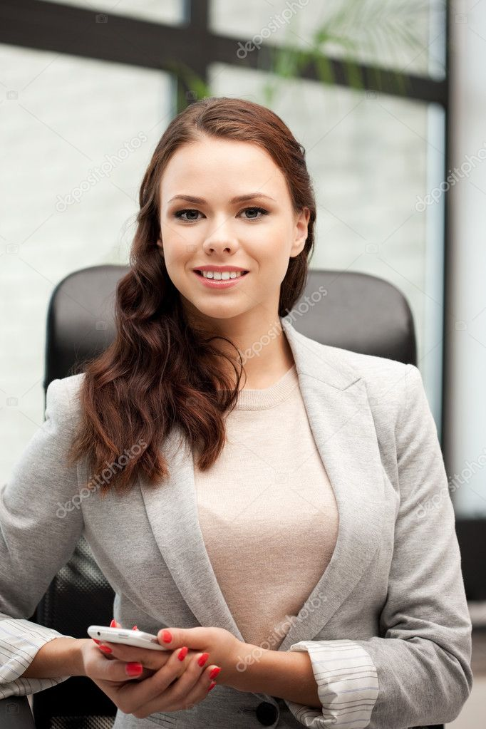 Bright picture of businesswoman with cell phone  Stock Photo #7267537