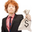 Man with dollar signed bag - Stock Photo