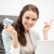 Happy woman with computer and euro cash money — Stock Photo