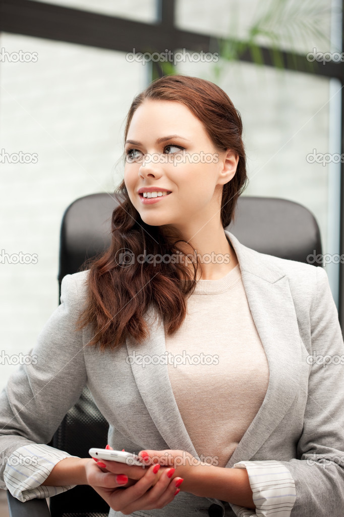 Bright picture of businesswoman with cell phone — Stock Photo #7279871