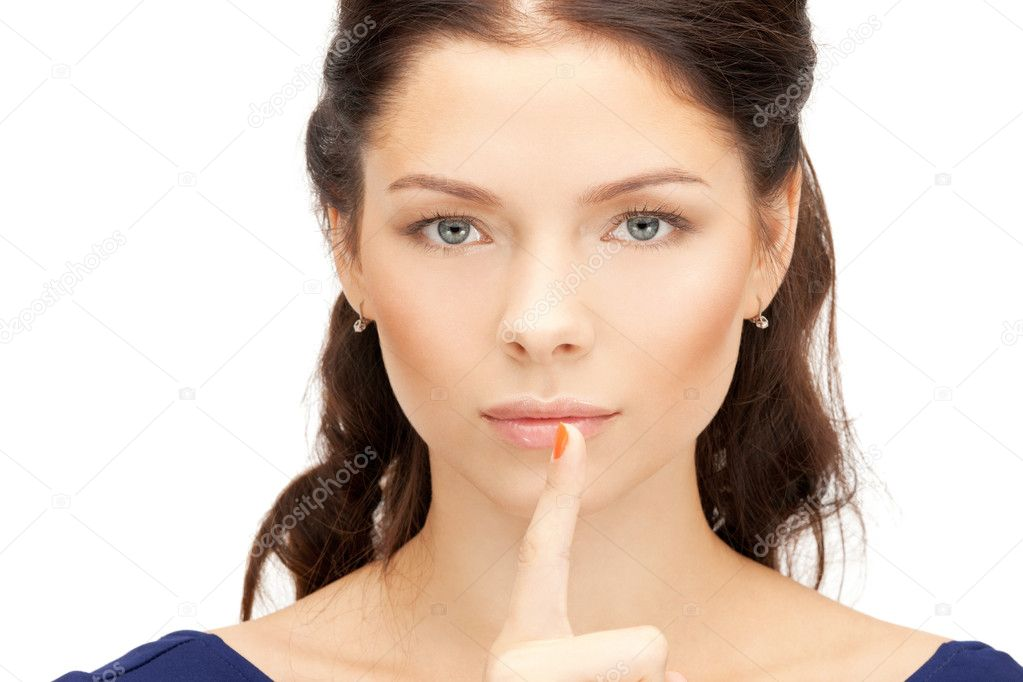 Bright picture of young woman with finger on lips  Stock Photo #7279895