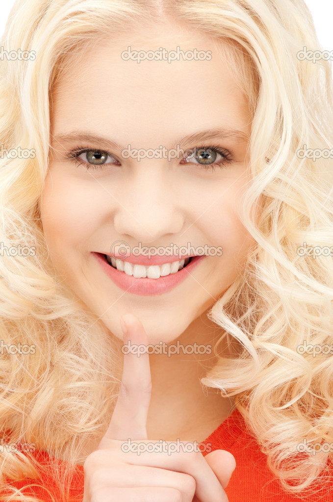 Bright picture of young woman with finger on lips — Stock Photo #7279910