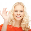 Lovely teenage girl showing ok sign — Stock Photo #7280007