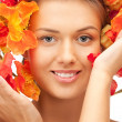 Lovely woman with red flowers — Stock Photo #7304163