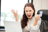 Unhappy woman with computer and euro cash money — Stock Photo