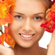 Lovely woman with red flowers — Stock Photo #7351660