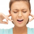 Woman with fingers in ears — Stock Photo #7403057