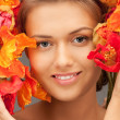 Lovely woman with red flowers - Stock Photo