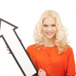Businesswoman with direction arrow sign — Stock Photo