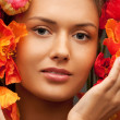 Lovely woman with red flowers — Stock Photo #7468479