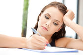 Calm woman with big notepad — Stock Photo