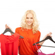 Lovely woman with clothes — Foto de Stock