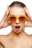Happy screaming teenage girl in shades — Stok fotoğraf