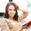 Happy and smiling woman with book — Stockfoto