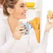 Lovely housewife with sandwich — Stock Photo