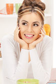 Lovely housewife with cup of muesli — Stock Photo