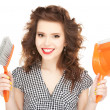 Beautiful womwith cleaning sweep — Stock Photo #7800688