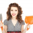 Beautiful woman with cleaning sweep - Stock Photo