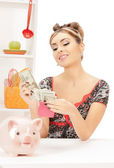 Beautiful housewife with purse and money — Stock Photo