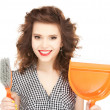Beautiful woman with cleaning sweep — Stock Photo #7826098