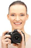 Teenage girl with digital camera — Stock Photo