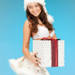 Santa helper girl in lingerie with gift box — Stock Photo