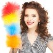 Beautiful womwith cleaning sweep — Stock Photo #7854016