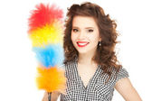 Beautiful woman with cleaning sweep — Stock Photo