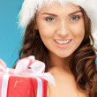 Santa helper girl with gift box — Stock Photo #7870890