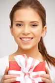 Happy teenage girl with gift box — Stock Photo