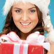 Stock Photo: Santa helper girl with gift box