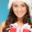 Santa helper girl with gift box — Stock Photo #7950847