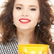 Lovely housewife with cup — Stock Photo #7962179