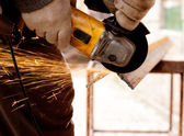 Worker cutting metal with sparks — Stock Photo