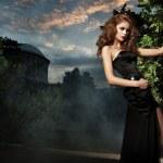 Sexy woman in stylish garden — Stock Photo