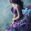 Cute woman in gorgeous dress - Stockfoto