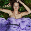 Beautiful woman laying on the grass - Stock Photo