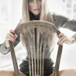 Cute woman sitting on a old chair — Stock Photo #7064234