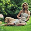 Stock Photo: Cute womwith dogs in beauty nature scenery