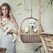 Stock Photo: Pretty girl with puppies