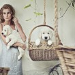 Pretty girl with puppies - Foto Stock