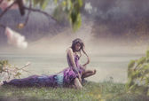 Beauty woman in fairy scenery — Stock Photo