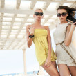 Two adorable women walking in a sunny day — Stock Photo