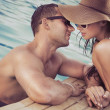 Attractive couple on poolside - Foto de Stock  