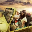 Adorable young ladies driving a cabriolet — Photo