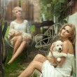 Stock Photo: Two beauty ladies with cute puppies