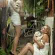 Two beauty ladies with cute puppies — Foto de stock #7466561