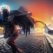 Raven woman running on empty city street — Stock Photo